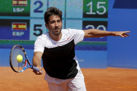 marc: Spanish tennis player Marc Lopez in action during his match against Bernard Tomic of Barcelona tennis tournament Conde de Godo on April 23, 2013 in Barcelona