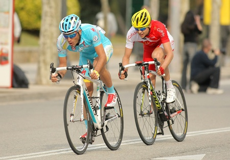 rudy: Alexsandr Dyachenko(L) of Astana and Rudy Molard(R) of Cofidis rides during the Tour of Catalonia cycling race through the streets of Monjuich mountain in Barcelona on March 24, 2013
