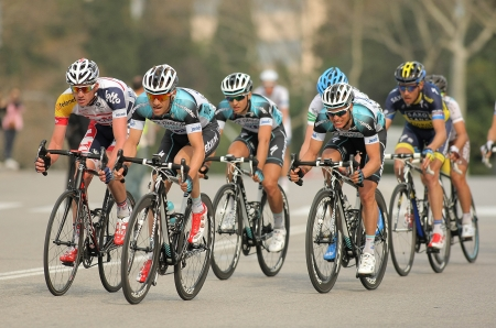 Pack of the cyclists of Omega Pharma Quickstep ride during the Tour of Catalonia cycling race through the streets of Monjuich mountain in Barcelona on March 24, 2013