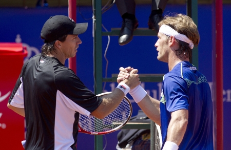 Argentinian tennis player Carlos Berlocq and Spanish Daniel Gimeno-Traver greet each other after his match against match of Barcelona tennis tournament Conde de Godo on April 23, 2013 in Barcelona