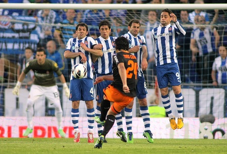 RCD Espanyol players on the wall of the free kick launched by Tino Costa of Valencia CF during a Spanish League match at the Estadi Cornella on April 13, 2013 in Barcelona, Spain Editorial