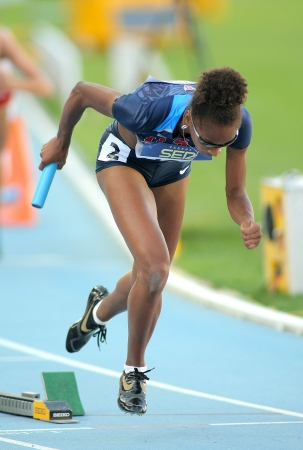 competes: Kendall Baisden of USA competes on 4X400 Relay of the 20th World Junior Athletics Championships at the Olympic Stadium on July 14, 2012 in Barcelona, Spain