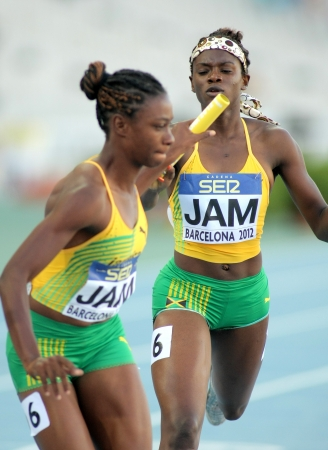 olivia: Olivia James L  and Sandrae Farquharson R  of Jamaica  competes on 4X400 Relay of the 20th World Junior Athletics Championships at the Olympic Stadium on July 14, 2012 in Barcelona, Spain Editorial