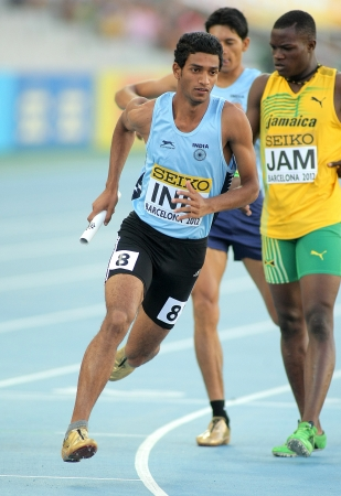 competes: Jeevan Karekoppa Suresh of India competes on 4X400 Relay of the 20th World Junior Athletics Championships at the Olympic Stadium on July 14, 2012 in Barcelona, Spain Editorial
