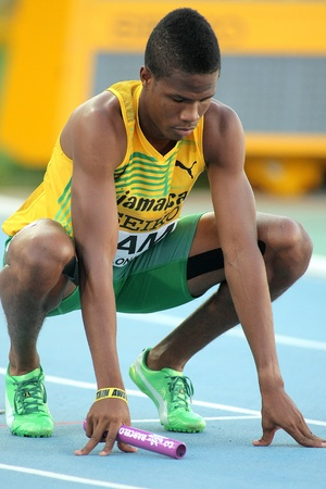 competes: Shavon Barnes of Jamaica competes on 4X400 Relay of the 20th World Junior Athletics Championships at the Olympic Stadium on July 14, 2012 in Barcelona, Spain