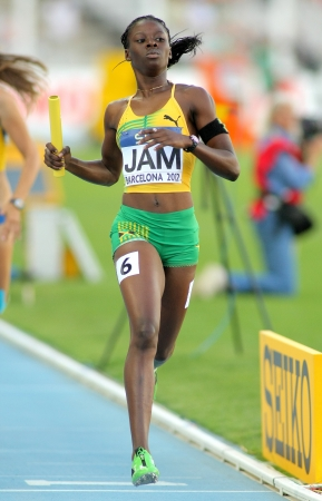 competes: Shericka Jackson of Jamaica competes on 4X400 Relay of the 20th World Junior Athletics Championships at the Olympic Stadium on July 14, 2012 in Barcelona, Spain
