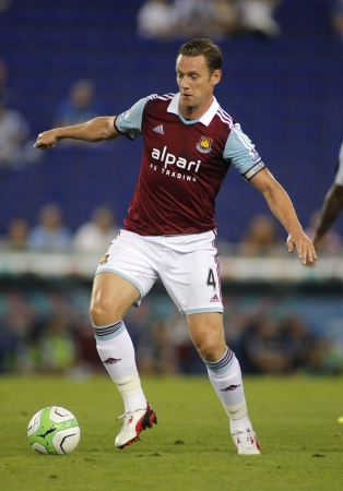 premier league: Kevin Nolan of West Ham United in action during before a friendly match against RCD Espanyol at the Estadi Cornella on September 5, 2013 in Barcelona, Spain