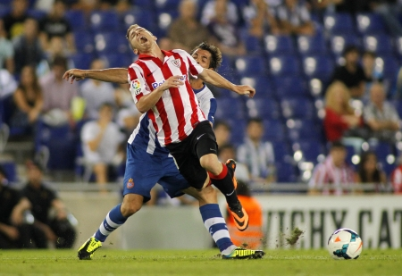 bodily: Iker Muniain of Athletic Bilbao in action during a Spanish League match between RCD Espanyol vs Bilbao at the Estadi Cornella on September 23, 2013 in Barcelona, Spain Editorial