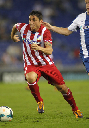 cristian: Cristian Rodriguez of Atletico de Madrid in action during a Spanish League match against RCD Espanyol at the Estadi Cornella on October 19, 2013 in Barcelona, Spain