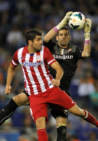 winger: Diego Costa L  of Atletico Madrid vies with Kiko Casilla R  of Espanyol during a Spanish League match at the Estadi Cornella on October 19, 2013 in Barcelona, Spain