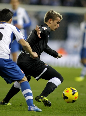winger: Antoine Griezmann of Real Sociedad in action during a Spanish League against RCD Espanyol match at the Estadi Cornella on November 30, 2013 in Barcelona, Spain