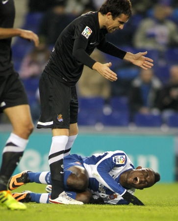 Mikel Gozalez U  of Real Sociedad discuss with Jhon Cordoba D  of Espanyol during a Spanish League match at the Estadi Cornella on November 30, 2013 in Barcelona, Spain