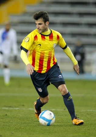 francesc: Catalan player Cesc Fabregas of Barcelona in action during the friendly match between Catalonia and Cape Verde at Olympic Stadium on December 30, 2013 in Barcelona, Spain Editorial