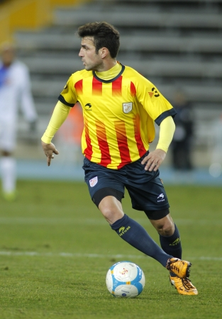 Catalan player Cesc Fabregas of FC Barcelona in action during the friendly match between Catalonia and Cape Verde at Olympic Stadium on December 30, 2013 in Barcelona, Spain