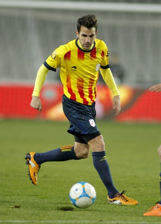 francesc: Catalan player Cesc Fabregas of FC Barcelona in action during the friendly match between Catalonia and Cape Verde at Olympic Stadium on December 30, 2013 in Barcelona, Spain  Editorial