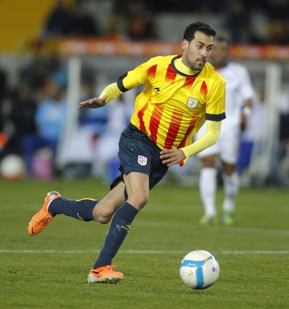 sergio: Catalan player Sergio Busquets of FC Barcelona in action during the friendly match between Catalonia and Cape Verde at Olympic Stadium on December 30, 2013 in Barcelona, Spain