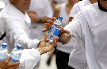 long distance: Runner take a bottle of water on a long distance race