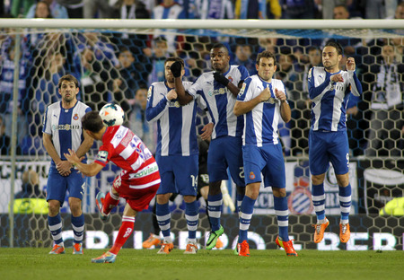 RCD Espanyol players on the wall of the free kick launched by UD Almeria during a Spanish League match at the Estadi Cornella on April 27, 2014 in Barcelona, Spain