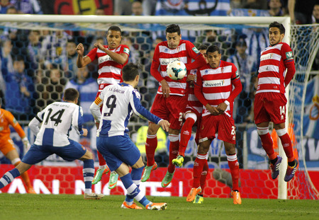 UD Almeria players on the wall of the free kick launched by Sergio Garica of RCD Espanyol during a Spanish League match at the Estadi Cornella on April 27, 2014 in Barcelona, Spain Editorial