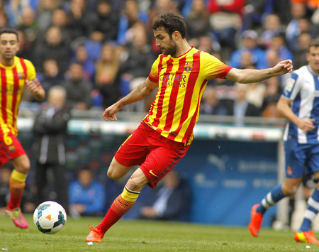 Cesc Fabregas of FC Barcelona in action during a Spanish League match against RCD Espanyol at the Estadi Cornella on March 29, 2014 in Barcelona, Spain