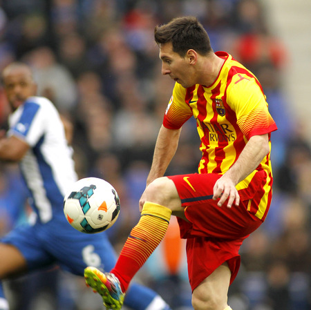 leo messi: Leo Messi of FC Barcelona in action during a Spanish League match against RCD Espanyol at the Estadi Cornella on March 29, 2014 in Barcelona, Spain Editorial