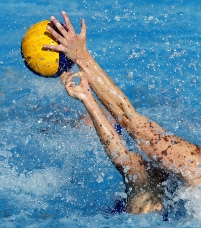 Two waterpolo players in actions during a match Stock Photo