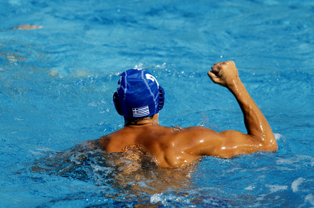 polo player: Waterpolo player celebrates goal during a match Stock Photo