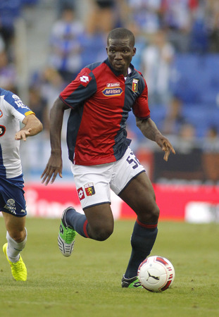 cfc: Moro Alhassan of Genoa CFC in action during a friendly match against RCD Espanyol at the Estadi Cornella on August 17, 2014 in Barcelona, Spain