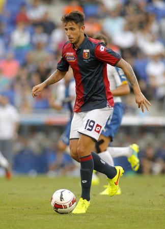 cfc: Leandro Greco of Genoa CFC in action during a friendly match against RCD Espanyol at the Estadi Cornella on August 17, 2014 in Barcelona, Spain