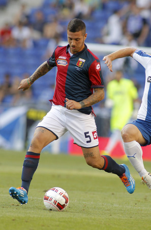 cfc: Armando Izzo of Genoa CFC in action during a friendly match against RCD Espanyol at the Estadi Cornella on August 17, 2014 in Barcelona, Spain Editorial
