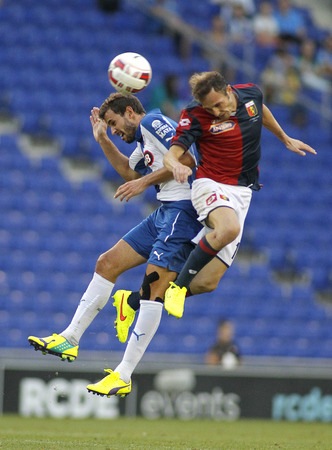 vying: Giovanni Marchese of Genoa CFC vies with Christian Stuani of RCD Espanyol during a friendly match  at the Estadi Cornella on August 17, 2014 in Barcelona, Spain Editorial