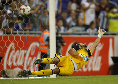 cfc: Mattia Perin of Genoa CFC in action during a friendly match against RCD Espanyol at the Estadi Cornella on August 17, 2014 in Barcelona, Spain