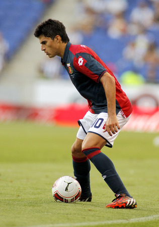 cfc: Diego Perotti of Genoa CFC in action during a friendly match against RCD Espanyol at the Estadi Cornella on August 17, 2014 in Barcelona, Spain