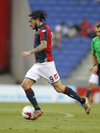 cfc: Mauricio Pinilla of Genoa CFC in action during a friendly match against RCD Espanyol at the Estadi Cornella on August 17, 2014 in Barcelona, Spain