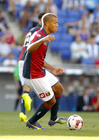 cfc: Sebastian De Maio of Genoa CFC in action during a friendly match against RCD Espanyol at the Estadi Cornella on August 17, 2014 in Barcelona, Spain