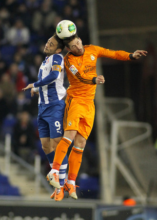 sergio: Sergio Garcia(L) of Espanyol vies with Sergio Ramos(R) of Real Madrid during the Spanish Kings Cup match at the Estadi Cornella on January 21, 2014 in Barcelona, Spain