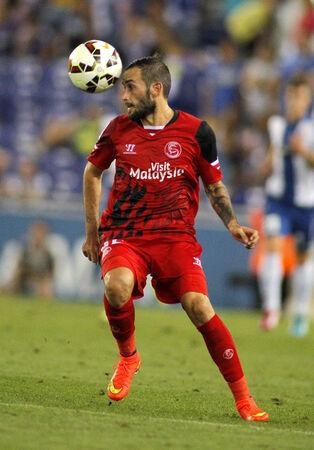 winger: Aleix Vidal of Sevilla FC during spanish league match against Espanyol at the Estadi Cornella on August 30, 2014 in Barcelona, Spain Editorial