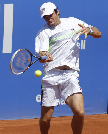 right handed: Russian tennis player Teymuraz Gabashvili in action during a match of Barcelona tennis tournament Conde de Godo on April 24, 2014 in Barcelona Editorial