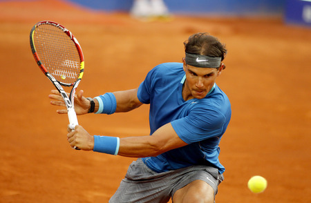 backhand: Spanish tennis player Rafa Nadal in action during a match of Barcelona tennis tournament Conde de Godo on April 24, 2014 in Barcelona