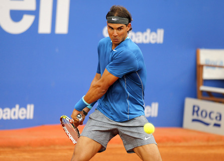right handed: Spanish tennis player Rafa Nadal in action during a match of Barcelona tennis tournament Conde de Godo on April 24, 2014 in Barcelona