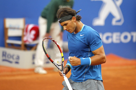 Spanish tennis player Rafa Nadal in action during a match of Barcelona tennis tournament Conde de Godo on April 24, 2014 in Barcelona