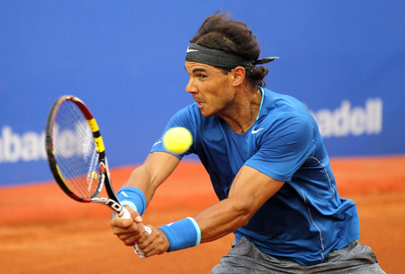 nadal: Spanish tennis player Rafa Nadal in action during a match of Barcelona tennis tournament Conde de Godo on April 24, 2014 in Barcelona