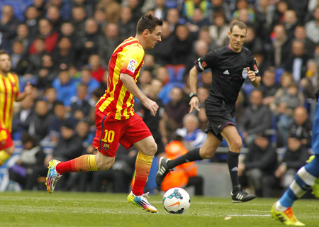 winger: Leo Messi of FC Barcelona in action during a Spanish League match against RCD Espanyol at the Estadi Cornella on March 29, 2014 in Barcelona, Spain Editorial