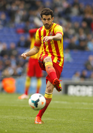 cesc: Cesc Fabregas of FC Barcelona in action during a Spanish League match against RCD Espanyol at the Estadi Cornella on March 29, 2014 in Barcelona, Spain