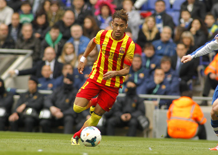 Neymar da Silva of FC Barcelona in action during a Spanish League match against RCD Espanyol at the Estadi Cornella on March 29, 2014 in Barcelona, Spain Editorial