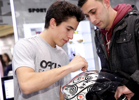 autograph: World champion motocycle racer Marc Marquez autograph signing in shopping center on December 9, 2014 in Barcelona, Spain