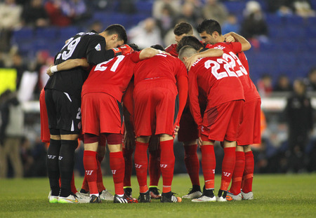 Sevilla FC players before Spanish League match against RCD Espanyol at the Estadi Cornella on January 22, 2015 in Barcelona, Spain