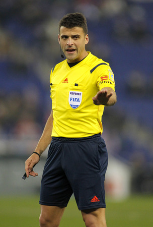 declaring: Referee Jesus Gil Manzano declaring a foul during a Spanish League match between Espanyol and Sevilla FC at the Estadi Cornella on January 22, 2015 in Barcelona, Spain