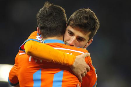 gaya: Jose Gaya embraces Pablo Piatti of Valencia CF during spanish League match against RCD Espanyol at the Estadi Cornella on February 8, 2015 in Barcelona, Spain