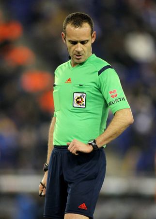 mario: Referee Mario Melero Lopez check the time during a Spanish League match between RCD Espanyol vs Valencia CF at the Estadi Cornella on February 8, 2015 in Barcelona, Spain
